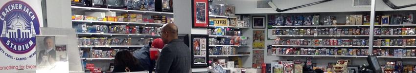 Customer browsing hockey cards at Crackerjack Stadium